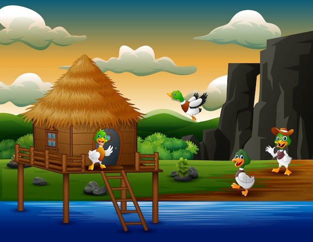 Cartoon eenden vliegt naar een hut aan de rivier