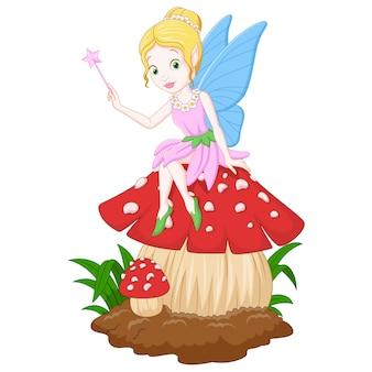 Cartoon fairy zittend op een paddestoel