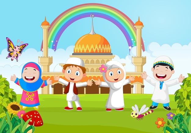 Cartoon gelukkig kind moslim met regenboog
