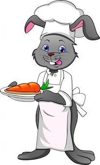 Cartoon gelukkig konijn chef-kok en wortel