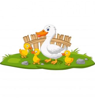 Cartoon gelukkig moeder eend en kuikens