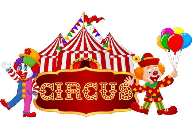 Cartoon gelukkige clowns met tent achtergrond