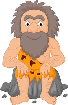 Cartoon gelukkige holbewoner zit