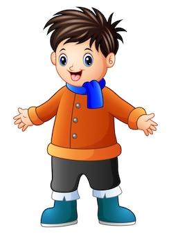 Cartoon gelukkige jongen in winterkleren
