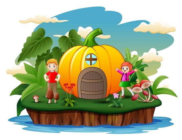 Cartoon gelukkige kinderen met pompoenhuis op het eiland