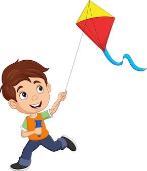Cartoon gelukkige kleine jongen die een vlieger speelt