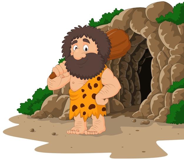 Cartoon holbewoner holding club met grot achtergrond