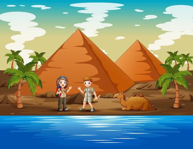 Cartoon illustratie van de verkennerskinderen die in de woestijn kamperen