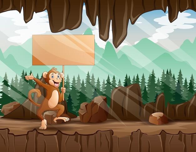 Cartoon illustratie van een aap met houten bord in de ingang van de grot