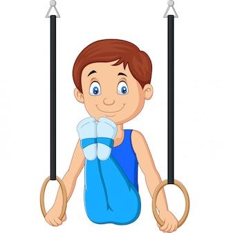 Cartoon jongen doet gymnastiek ringen