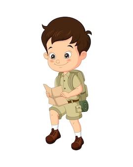 Cartoon jongen ontdekkingsreiziger met kaart