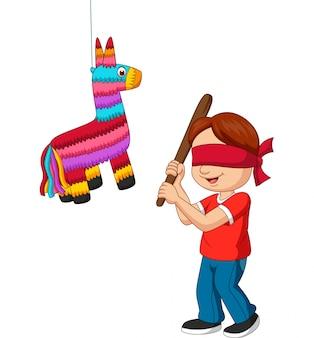 Cartoon jongen raakt pinata spel