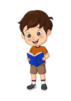 Cartoon jongen student staat en leest een boek