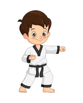 Cartoon karate jongen die karate beoefent