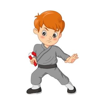 Cartoon karate jongen nunchaku te houden