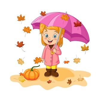 Cartoon klein meisje in herfstkleren met paraplu