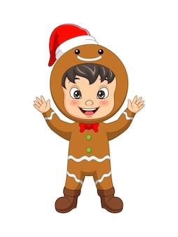 Cartoon kleine jongen die koekjeskostuum draagt