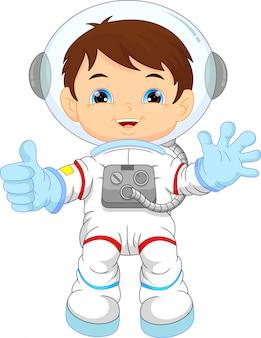 Cartoon kleine jongen draagt astronaut kostuum