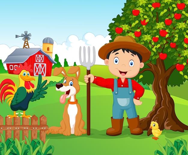 Cartoon kleine jongen en hond in de boerderij