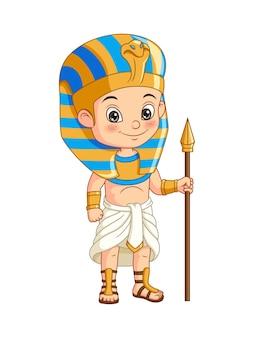Cartoon kleine jongen in egyptisch faraokostuum