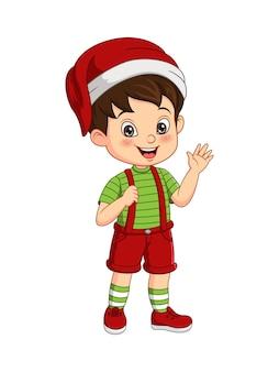 Cartoon kleine jongen in kerstkostuum