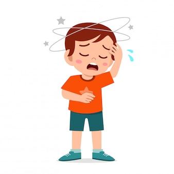 Cartoon kleine jongen jongen krijgt slechte hoofdpijn