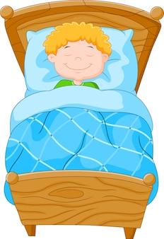 Cartoon kleine jongen viel in slaap
