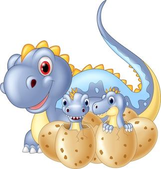 Cartoon moeder dinosaurus en baby dinosaurussen broedeieren