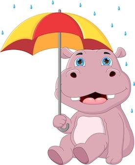 Cartoon nijlpaard schuilplaats met paraplu in de regen