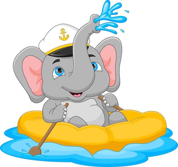 Cartoon olifant zeilen op een opblaasbare boot