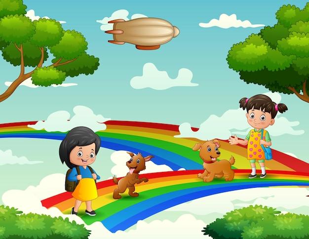 Cartoon schattige meisjes wandelen met hun huisdieren op de regenboog