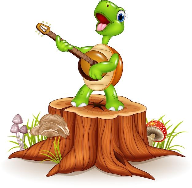 Cartoon schildpad een gitaar spelen op boomstronk