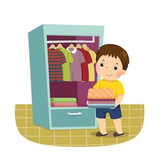 Cartoon van een kleine jongen stapel gevouwen kleren aanbrengend kast. kinderen doen van huishoudelijke klusjes thuis concept.