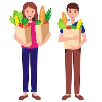 Cartoon vectorillustratie met jongen en meisje met papieren boodschappentassen met gezond voedsel geïsoleerd op een witte achtergrond