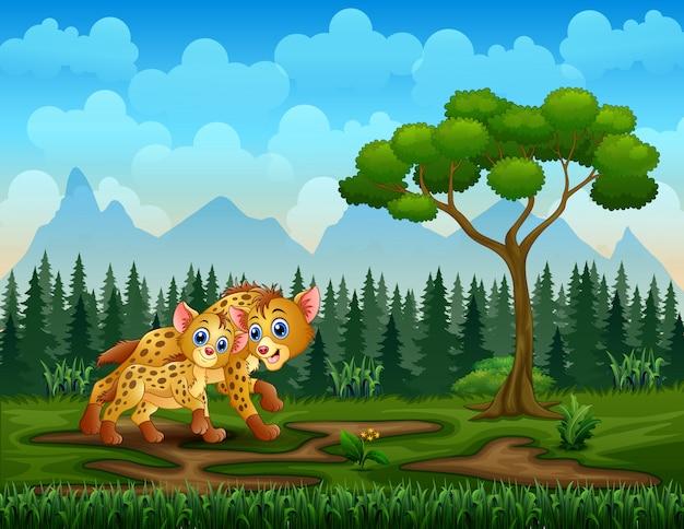Cartoon volwassen hyena en welp hyena in het veld
