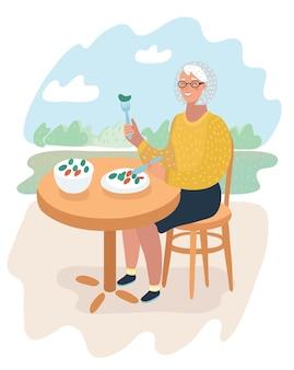 Cartoonillustratie van oudere vrouw die haar gezonde maaltijd aan tafel neemt