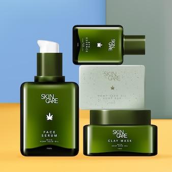 Cbd-hennepzaadolie huidverzorging en lichaamsverzorgingsset met tinted green facial serum of eye essence pump glazen fles, clay mask jar en exfoliating soap bar.