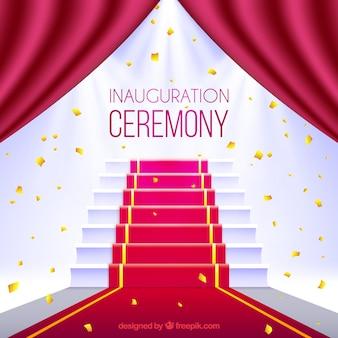 Ceremonie met rood tapijt en trap