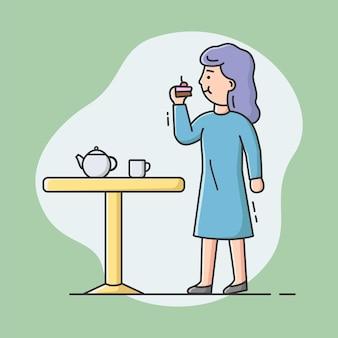 Cheat meal en een gezonde levensstijl concept. jonge mooie vrouw eet taart en drinken thee. meisje bedriegt haar dieet, eet ongezond voedsel.