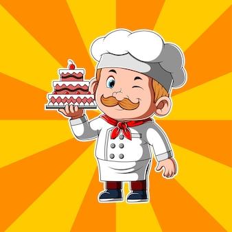 Chef-kok die mooie cake met kers op bovenkant houdt