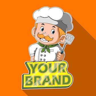 Chef-kok met spatel met banner voor merk
