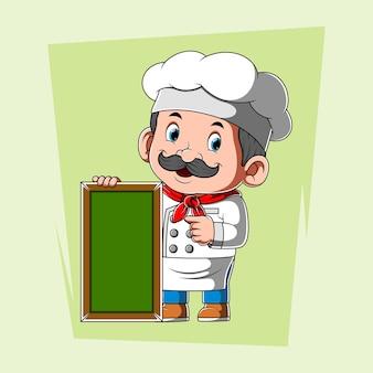 Chef-kok met witte schort met groen leeg bord