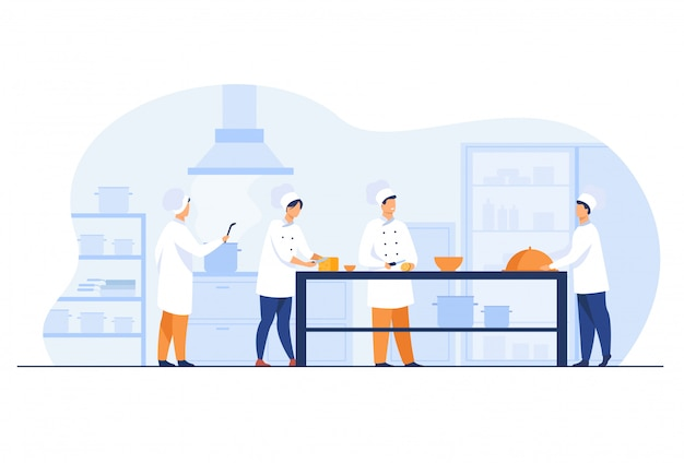 Chef-koks, koks en obers die bij restaurantkeuken werken