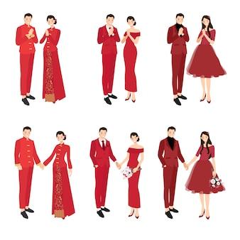 Chinees huwelijkspaar in traditionele rode kledingsgroet voor chinese nieuwe jaarinzameling