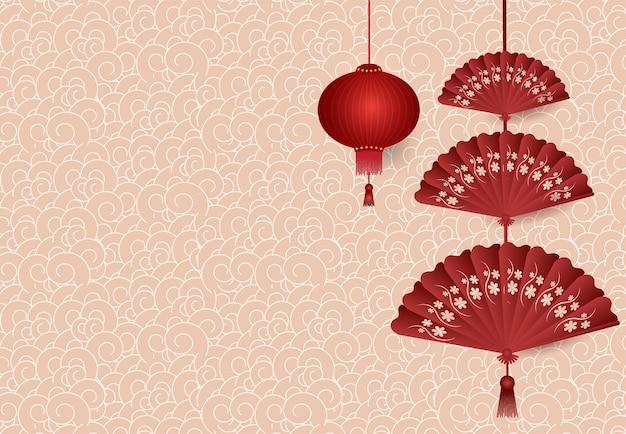 Chinese lantaarn vouwende ventilator die op patroon hangen