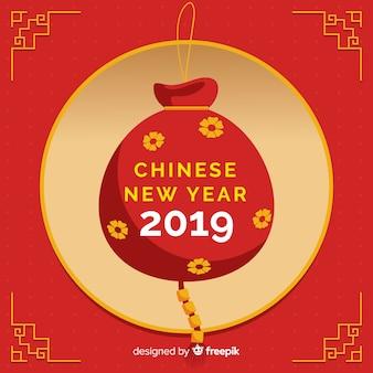 Chinese nieuwe jaarachtergrond met rode zak