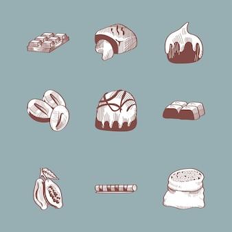 Chocoladesnoepje en ingrediënten die op grijs worden geplaatst