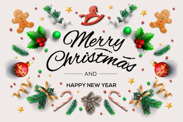 Christmas wenskaart met kalligrafische seizoenswensen en samenstelling van feestelijke elementen zoals koekjes, sterren, bessen, kerstboomversieringen, pijnboomtakken.