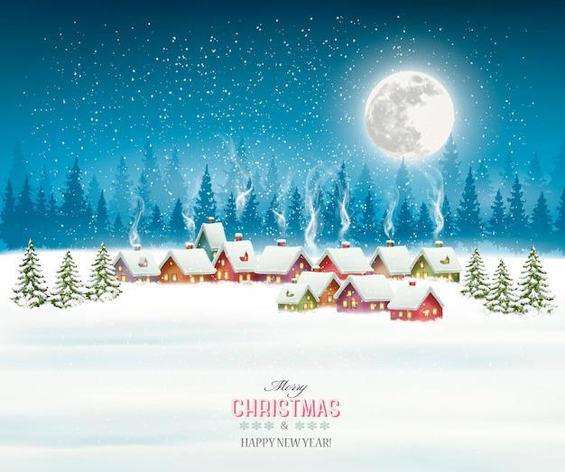 Christmas wenskaart tegen sneeuw bedekt dorp