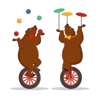 Circusberen jongleren op een fiets. vector cartoon illustratie.